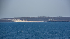 Perim Island and Lighthouse, Yemen, from the Gulf of Aden (Peter.Stokes) Tags: colour cruise2019 landscape ocean outdoors photo photography sea water yemen
