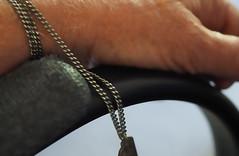 Chained (LeftCoastKenny) Tags: utata ironphotographer necklace pendant hand chair arm utata:description=hide utata:project=ip290 noir
