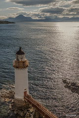 Kyleakin Lighthouse and the Island of Skye from the Skye Bridge, Kyle of Lochalsh. (Scotland by NJC.) Tags: coastline 海岸线 litoral côte küste linea costiera 海岸線 해안선 seashore coast shore seaboard seaside beach strand mountains hills highlands peaks fells massif pinnacle ben munro heights جَبَلٌ montanha 山 planina hora bjerg berg montaña vuori montagne βουνό montagna fjell island isle islet archipelago atoll key جَزِيرَةٌ ilha 岛屿 otok ostrov ø eiland isla saari île insel νησί isola kyleakinlighthouse skyebridge isleofskye kyleoflochalsh scotland