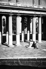 quiet corner (khrawlings) Tags: venice italy monochrome bw blackandwhite man reading book camposanfrancesco pillars columns campiello della confraternita