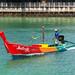 Traditional Thai Longtail Fishing boat with bright colors. Rawai beach, Phuket island, Thailand 10-10-2019