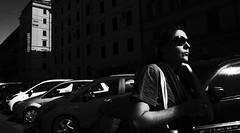 Sound of the city. (Baz 120) Tags: candid candidstreet candidportrait city contrast street streetphoto streetcandid streetportrait strangers rome roma ricohgrii europe women monochrome monotone mono noiretblanc bw blackandwhite urban life portrait people provoke italy italia grittystreetphotography faces decisivemoment