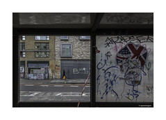 Shoreditch through a Bus Stop Window © (wpnewington) Tags: broken vandalism busstop london greatbritain unionjack shoreditch politics grafitti bus window