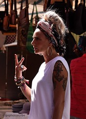 The cool waitress (stewardsonjp1) Tags: food woman tattoo restaurant cool style funky sicily waitress bandana ortigia italy jewellery streetphotography statement coolchic hair bohemian portrait