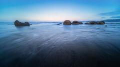 Boulders (FireDevilPhoto) Tags: nature beach sea water landscape sunset sky outdoors scenics coastline tranquilscene bluerock object reflection dusk beautyinnature nopeople summer longexposure horizon overwater moerakiboulders newzealand sony a9 laowa wideangle ultra