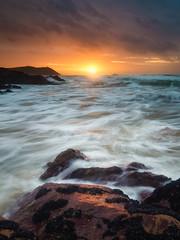 Polzeath Rush (Timothy Gilbert) Tags: wideangle sunset polzeath panasonic boulders rocks panasonic1235mmf28x beach m43 microfourthirds wave microfournerds lovecornwall gx8 coast cornwall lumix