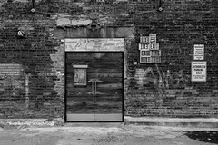 (Dan Fleury Photos) Tags: toronto ontario canada to tdot 416 yyz downtown street black white mono monochrome blackandwhite door exit texting brich brick wall tagged the6ix