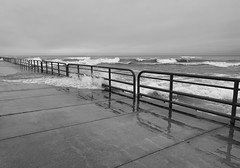 Washing over (mswan777) Tags: pier railing water wet waves crash sky cloud horizon outdoor reflection apple iphone iphoneography mobile ansel monochrome black white seascape shore coast weather michigan