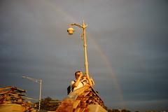 Rainbow (dtanist) Tags: nyc newyork newyorkcity new york city sony a7 7artisans 35mm brooklyn bath beach shore promenade gold golden rainbow lamp post lamppost locals sky cloudy