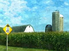 45 MPH (novice09) Tags: farm barn silos cornfield sign wisconsin painterly oil ipiccy fotosketcher digitalartpainting