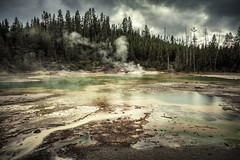 Crackling Lake (byron bauer) Tags: byronbauer thermal pool fumaroles steam hot water springs color bacteria rain mud clouds trees storm painterly reflections heat shadows lodgepole pine caldera archaea geyser baisn yellowstone topaz simplify restyle impression sulfur