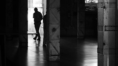 EXIT (Lea Ruiz Donoso) Tags: black white blanco negro monochrome monocromatico urban urbano city ciudad silhouette silueta interior inside light luz backlight street calle textures texturas shadow sombra shadows sombras people gente man hombre madrid atmosphere atmosfera one person persona building edificio construccion structure estructura architecture arquitectura lines lineas shapes formas lights luces moment momento capture captura líneas columnas dark 2019 nikon