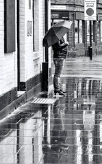 Parked (sasastro) Tags: mono blackwhite rain reflections wet wetday weather streetphotography candid people pentaxk5iis smcpentaxda18135mm street ipswich suffolk