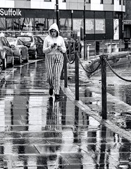 Suffolk Stripes (sasastro) Tags: mono blackwhite rain reflections wet wetday weather streetphotography candid people pentaxk5iis smcpentaxda18135mm street ipswich suffolk