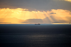 Rays of God (athanecon) Tags: saronic gulf saronicgulf sailing calm absolutecalm calmness sea ship island aegina aeginaisland attica greece light silhouettes lines colors colours sky fireinthesky deepblue hill hills goldenhour clouds nikon nikond750 d750 nikonphotography nikon70300mm 70300 sunset tramonto ocaso coucherdesoleil lightrays raysoflight sunrays sunlight rays raysofgod