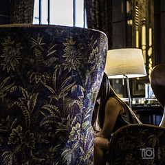 Conversation - Singapore (Paul Perton) Tags: dof singapore xh1 zeiss35mmf14distagon bar blur bokeh chair hotel lounge square street streetphotography urban