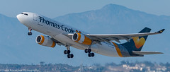 Thomas Cook A-330 flying off into the sunset (Alaskan Dude) Tags: lax klax losangelesinternationalairport planewatching planespotting airplanes airlines aviation aircraft
