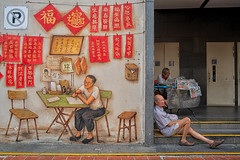 singapore (Roberto.Trombetta) Tags: asia singapore chinatown graffiti smoking cigarette newspaper seller hawkers man sitting seated relax street work working people tourist summer girl sony alpha 7rm2 7rii batis225 carl zeiss batis 25 fine art fineart persone smith