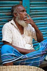 Man smoking in Old Dhaka (rossjamestanner) Tags: bangladesh portrait streetphotography person people smoking dhaka olddhaka