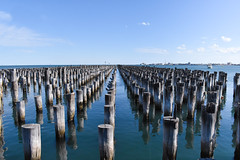 Remnants of a pier - Port Melbourne (Marian Pollock) Tags: melbourne portmelbourne portphilipbay australia bay water sea relics shadows stumps pilons port old victoria waterscape sunny outdoor seascape reflections bluesea horizon ship