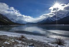 Alberta scene (Robert Grove 2) Tags: sunburst mountains clouds lake canada alberta ice