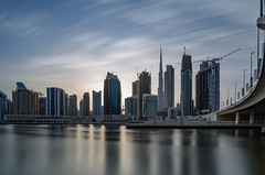 Ever Changing... (Aleem Yousaf) Tags: sunset skyline digital skyscraper golden construction long exposure downtown dusk cranes changing hour nikkor burj longexposure drag happy canal dubai united uae style east emirates khalifa arab lee middle flickrclouds street bridge reflections real bay estate business filter commercial properties density neutral emmar damac alabraj waterfront muted d810 wide angle 1835mm memories