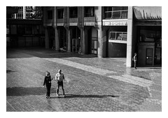 FILM - Three figures at Lauderdale Tower (fishyfish_arcade) Tags: 35mm analogphotography bw barbican blackwhite blackandwhite filmphotography filmisnotdead hp5 istillshootfilm london monochrome olympusom1 zuiko50mmf18 analogcamera film ilford mono streetphotography