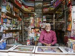 The end of an era, last days of a shop in the Chor Bazaar, Mumbai (Yekkes) Tags: asia india mumbai bombay maharashtra chorbazaar shop smallshop shopkeeper spectacles pinkshirt muslim endofanera indian