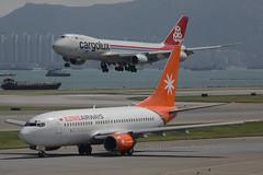 "Boeing, 737-73V, EI-ULN, ""Eznis Airways"", VHHH, Hong Kong (Daryl Chapman Photography) Tags: eiuln boeing 737 73g 73773v mg eza 1474 32426 eznisairways lxvci 747 748 748f 7478f 7478r7f cargolux 1478 35822 hongkong china sar cheklapkok hongkonginternationalairport vhhh plane planes planespotting holiday departure aviation aviationphotography"