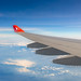 Flight of Airbus A340 of Turkish Airlines over the Himalayas, India, Sept 2019