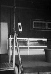 Abandoned loading dock (Sonofsono) Tags: submini black bw white 16mm svema expired filter film finland minolta minolta16