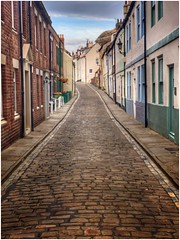 Narrow street (Andy Stones) Tags: henrietta street streetview road cobbles uphill houses urban whitby yorkshire nyorks town sky cloud clouds quiet image imageof imagecapture photography photoof path pathway