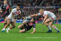 Jake Bibby is brought down-1959 (G I Lyons) Tags: rugbyleague betfredsuperleague grandfinal oldtrafford salfordreddevils sthelens saints trafford greatermanchester unitedkingdom