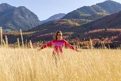 Kellie in a Field of Dry Grass (aaronrhawkins) Tags: dry grass field mountain fall autumn colors orange red beautiful walk hike kellie arms evening afternoon utah provo canyon southfork road season aaronhawkins