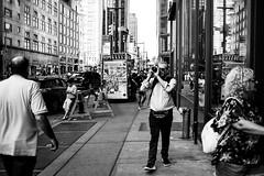 Photographer (Nun Nicer Artist) Tags: manhattan photographer city monochrome blackandwhite 35mm 35mmstreetphotography streetphotography bnw nyc camera street newyork nunnicer