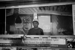 Cook (Nun Nicer Artist) Tags: foodcart manhattan travel food 35mmstreetphotography streetphotography blackandwhite monochrome nunnicer city citylife bnw urban street streetvendor