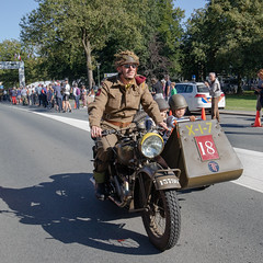 """""""Race to the bridge"""" with 300 restored WWII British Airborne vehicles from Renkum to the John Frost Bridge and back to the Airborne museum in Oosterbeek. (PeteMartin) Tags: 75 arnhem bridge commemoration event history kids marketgarden motorbike parade race restored sidecar transport vehicles vintage war oosterbeek gelderland netherlands"""