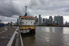 A Slice of Reality (Spannarama) Tags: stormy clouds darkclouds canarywharf docklands buildings skyline architecture river thames sunlight thamespath northgreenwich london uk asliceofreality boat crosssection artinstallation