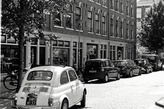 Amsterdam (KRVDC) Tags: krvdc black white photography amsterdam canal boat weed people portrait landscape fiat film photo photograph photographer analog analogue travel pictures bw canon ae1 36mm 50mm contrast