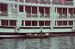 Boat Vendor (hiphopmilk) Tags: copyright©jaredyehwooehmoehfilms film analog analogue 35mm 135film kodakfilm kodak jaredyeh hiphopmilk nikonfm2 nikonfm2n nikon nikkor vietnam hanoi travel halongbay vịnhhạlong tuần châu sea ocean bay cruise ship boat ferry raft vendor dinghy