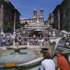 La Barcaccia fountain with the Spanish Steps in the background. (Lobster account) Tags: steps stairway european italian piazza travel europe capital spanish urban architecture famous city spagna cityscape basilica monument church rome touristic fountain roman italy view summer old landmark square spain landscape history illuminated roma bernini day water outdoor historic holiday trinita people spanishsteps sightseeing popular building barcaccia