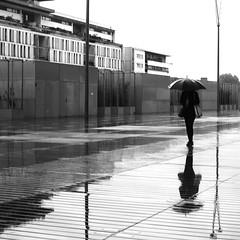 In the umbrella (pascalcolin1) Tags: paris13 femme woman pluie rain parapluie umbrella reflets reflection photoderue streetview urbanarte noiretblanc blackandwhite photopascalcolin 50mm canon50mm canon