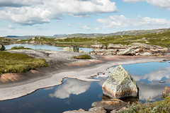 Slick (Raphs) Tags: norge norway hardangervidda fjell highland lake pond water surface smooth reflection sky blue still rocks nature clean pristine untouched raphs canoneos70d canonefs1585mmf3556isusm