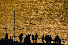 Golden sea (RobMenting) Tags: liguria landscape sunset nature people italy evening light sun man beach silhouette travel golden outdoors water europe vernazza sea landschap laspezia italië