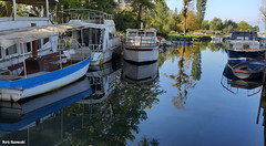 Boat parking (borisnaumoski) Tags: ohrid macedonia boats reflection lake october autumn nature