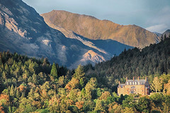 Mansion in the forest (OutdoorMonkey) Tags: house mansion building hotel scotland highlands lochaber glencoe mamores mountain mountains mountainside tree trees wood woods forest sunshine sunlight evening outside outdoor scenic scenery countryside rural lochleven
