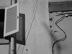 Communication Breakdown (Andy WXx2009) Tags: blackandwhite windows telephone monochrome cambrils spain europe artistic abstract wall building architecture shadows sunlight costabrava resort urban decay streetphotography stilllife light outdoors