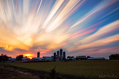 Six Silo Sunset (Matt Molloy) Tags: nature sunset colorful sky clouds trails sun barn silos field farm countryside landscape skyscape seeleysbay leedsandthethousandislands ontario canada explorecanada exploreontario mattmolloy timelapse photography timestack photoshop canon cloudporn cloudoholic outdoors trippy