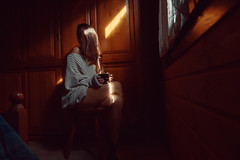 Beautiful Girl In A Chalet (SplitShire) Tags: night light fashion wood girl dark people portrait chair photography woman room standing female adult fun sitting looking open door indoor furniture person one model clothing human darkness interiordesign cabinet