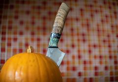 Autumn (Pittypomm) Tags: 2019p52 week41 autumn season seasonal pumpkin knife stab stabbed tiles distorted orange red handle blade